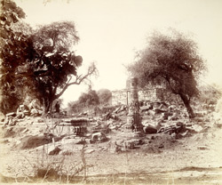 General view of ruins and standing pillar at Chandravati 1867